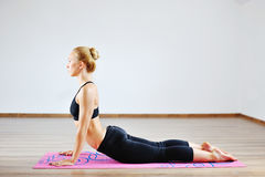 Young beautiful woman doing yoga indoors Royalty Free Stock Photo