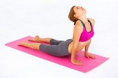Young beautiful woman doing yoga. Stock Photo