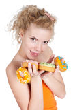 Young beautiful woman with donuts  over white Royalty Free Stock Images