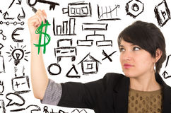 Young beautiful woman drawing money symbol with Royalty Free Stock Photos