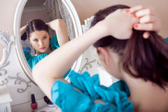 Young beautiful woman with dress apply makeup. Royalty Free Stock Photo