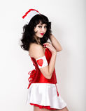 Young beautiful woman dressed as nurse, medical carnival costume, she holding a stethoscope Royalty Free Stock Photography