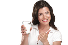 Young beautiful woman drink a glass ok milk Royalty Free Stock Image
