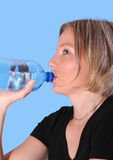 Young beautiful woman drinking. Water Royalty Free Stock Photo