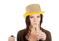 Young beautiful woman is drinking a champagne. Royalty Free Stock Image