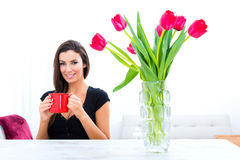 Young beautiful woman drinking coffee at home Royalty Free Stock Images
