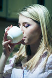 Young and beautiful woman drinking coffee at home Royalty Free Stock Photo