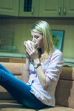 Young and beautiful woman drinking coffee at home Stock Images