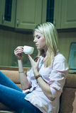 Young and beautiful woman drinking coffee at home Stock Photos