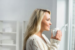 Young and beautiful woman drinking coffee Royalty Free Stock Image