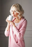 Young and beautiful woman drinking coffee Stock Images