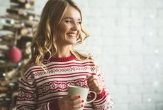 Young beautiful woman drinking cup of coffee blurred winter snow tree background. Young beautiful woman drinking cup of coffee or tea. blurred winter snow tree Stock Photos