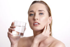 Young beautiful woman drinking fresh water on white Stock Photos