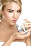 Young beautiful woman drinking fresh water on white Stock Photography