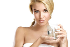 Young beautiful woman drinking fresh water on white Royalty Free Stock Image