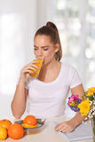 Young beautiful woman drinking a glass of orange juice Royalty Free Stock Photo