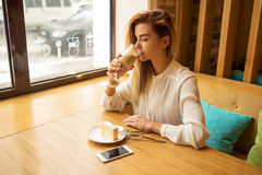 Young beautiful woman drinking latte Royalty Free Stock Photo