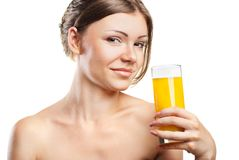 Young beautiful woman drinking orange juice Stock Photo