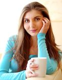 Young beautiful woman drinking tea at home Royalty Free Stock Image