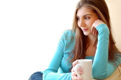 Young beautiful woman drinking tea at home Royalty Free Stock Photography