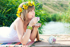 Young Beautiful Woman drinking tea Outdoors in Summer. Stock Photo