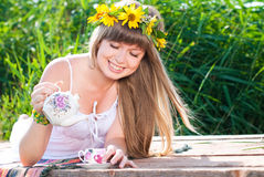 Young Beautiful Woman drinking tea Outdoors in Summer. Stock Images