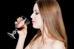 A young beautiful woman drinking wine Stock Photography