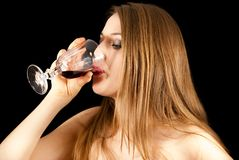 A young beautiful woman drinking wine Royalty Free Stock Images