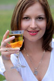Young beautiful woman drinking wine outdoor Royalty Free Stock Photo