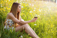 Young beautiful woman drinking wine outdoors royalty free stock images