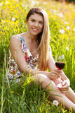 Young beautiful woman drinking wine outdoors Stock Photography