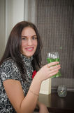 Young beautiful woman drinks  cocktail Stock Photo