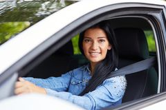 Young woman driving her car. Young beautiful woman driving her car royalty free stock photo