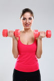 Young beautiful woman with dumbbells Stock Photography