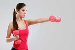 Young beautiful woman with dumbbells Royalty Free Stock Photography