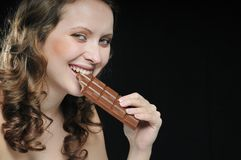 Young beautiful woman eating Stock Images