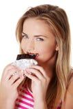 Young beautiful woman eating bar Royalty Free Stock Photos