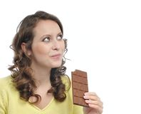 Young beautiful woman eating chocolate Stock Images