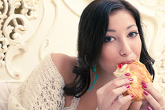 Young beautiful woman eating croissant with jam Royalty Free Stock Photo