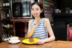 Young beautiful woman eating a dessert Royalty Free Stock Image