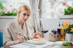 Young beautiful woman eating a dessert. At the restautant Stock Photography