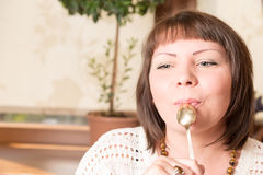 Young beautiful woman eating a dessert. Sweet life with cake Stock Photos