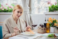 Young beautiful woman eating a dessert. At the restautant Stock Photo