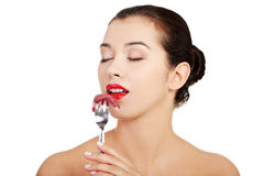 Young beautiful woman eating raw meat. Royalty Free Stock Images