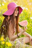 Young beautiful woman eating a watermelon Stock Image