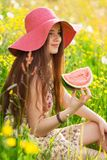 Young beautiful woman eating a watermelon Royalty Free Stock Images