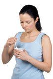 Young beautiful woman eating yogurt Royalty Free Stock Photo