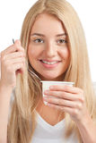 Young beautiful woman eating yogurt Royalty Free Stock Photography