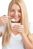 Young beautiful woman eating yogurt Stock Image