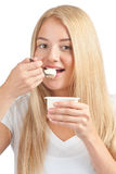 Young beautiful woman eating yogurt Royalty Free Stock Images